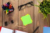 Notepad, colorful pencils, supplies and flower — Stock Photo