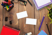 Office table with notepad, colorful pencils, supplies — Stock Photo