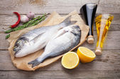 Fresh dorado fish cooking with spices — Stock Photo