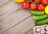Fresh ripe vegetables on wooden table — Stock Photo