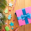 Gift box over christmas wooden background — Stock Photo #56528009