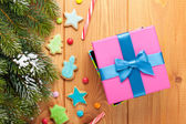 Gift box over christmas wooden background — Stock Photo