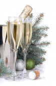 Champagne, blue firtree and christmas decor — Stock Photo