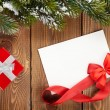Christmas gift box and blank greeting card — Stock Photo #57141159