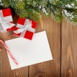 Christmas gift boxes and greeting card — Foto de Stock   #57141747