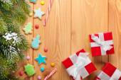 Fir tree, gingerbread cookies and gift boxes — Stock Photo