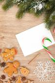 Christmas fir tree, gingerbread cookies and card for copy space — Stok fotoğraf