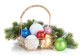 Colorful christmas baubles and fir tree — Stock Photo
