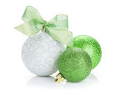 Christmas baubles and green ribbon — Stock Photo