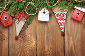 Christmas fir tree and birdhouse decor — Stock Photo