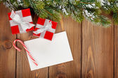 Christmas gift boxes and greeting card — Stock Photo