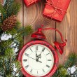Christmas clock, gifts and fir tree — Stock Photo #57722413