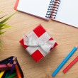Red gift box and office supplies — Stock Photo #57722473