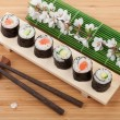 Постер, плакат: Sushi maki set and sakura branch