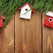 Christmas fir tree and birdhouse decor — Stock Photo #57722531