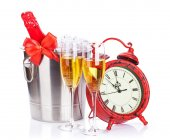 Champagne and christmas clock — Stock Photo