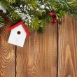 Christmas fir tree and birdhouse decor — Stock Photo #58859747