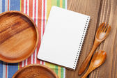 Wood kitchen utensils with notepad — Stock Photo