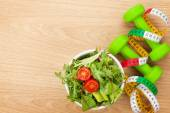 Dumbbells, tape measure and healthy food. — Stock Photo
