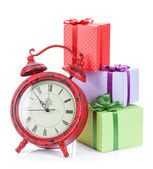Christmas clock and three gift boxes — Stock Photo