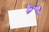 Greeting card with purple bow — Stock Photo