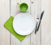 Empty plate, cup and silverware — Stock Photo