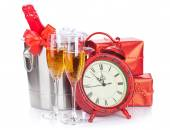 Champagne glasses, bottle in cooler and clock — Stock Photo