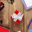 Red gift box and office supplies — Stock Photo #59297265