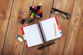 Office table with notepad and supplies — Foto Stock