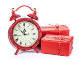Christmas clock and two gift boxes — Stock Photo