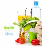Dumbells, tape measure and healthy food — Stock Photo
