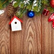 Christmas wooden background with fir tree — Stock Photo #59357935