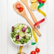 Fresh healthy salad and tape measure — Stock Photo #59358277