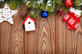 Christmas wooden background with fir tree — Стоковое фото