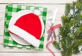 Santa hat on plate — Stockfoto