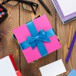 Gift box and office supplies over office table — Stock Photo #59817087