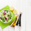 Fresh healthy salad and condiments over white wooden table — Stock Photo #59817275