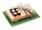 Sushi maki set with salmon and cucumber and sakura branch — Stock Photo