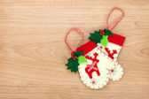 Christmas mitten decor on wooden background — Stock Photo
