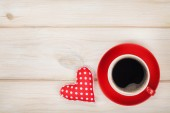 Coffee cup with toy heart gift — Stock Photo