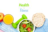 Dumbell, tape measure, healthy food and towels — Stock Photo