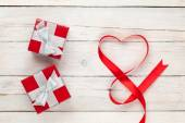 Valentines day heart shaped ribbon and gift boxes — Stock Photo