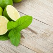 Fresh ripe limes with mint — Stock Photo #60346595