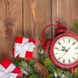 Christmas background with clock, gift boxes and snow fir — Stock Photo #60346899