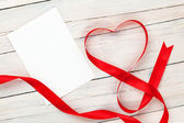 Valentines day heart shaped red ribbon and blank greeting card — Stock Photo