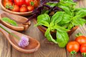 Fresh farmers tomatoes and basil — Stock Photo
