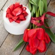 Red tulips and valentines day gift box — Stock Photo #61641217