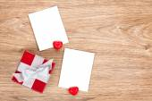 Photo frames and small red gift box — Stock Photo