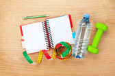Dumbells, tape measure, water bottle and notepad — Stock Photo