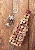 Wine shaped bottle by corks — Stock Photo
